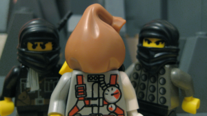 The hooded minifig is unmasked during the 5 minute video